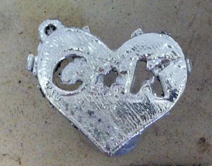 Close up on charm right after casting...